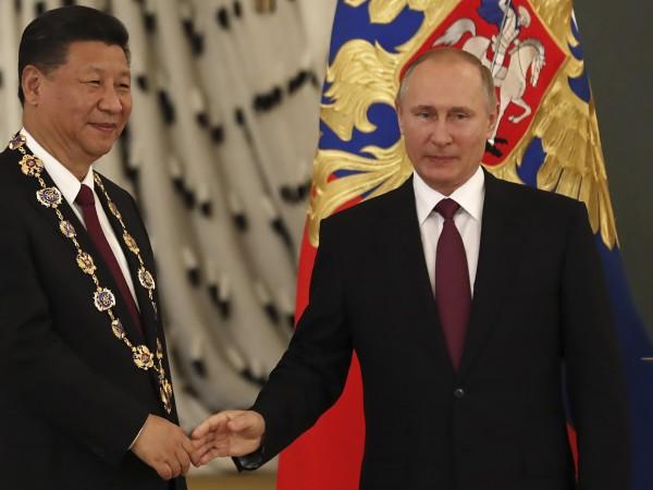 Лидерите на Китай и Русия се зарекоха да работят заедно